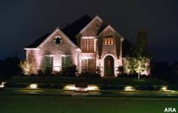 We used decorative outdoor lighting to add curb appeal to this house.