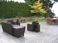Nice patio with rattan furniture and view of the ocarn
